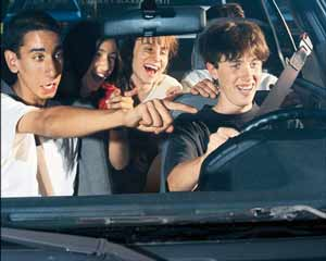 Teen driver with laughing teen passengers