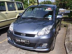 A bluish silver sedan