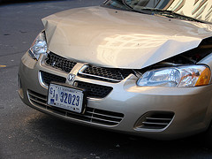 silver brown car with bumped hood
