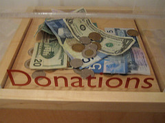 Bills and coins in a donation box