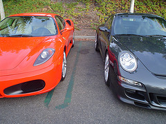 A red Ferrari and a black Porsche