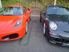 A red Ferrari and a black Porsche