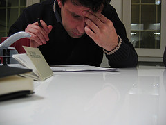 Man looking worried before signing papers