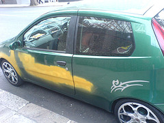 Green car with yellow primer