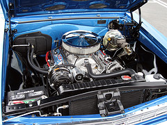 Open hood of a blue car