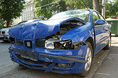 Wrecked  frontal view of a blue sedan